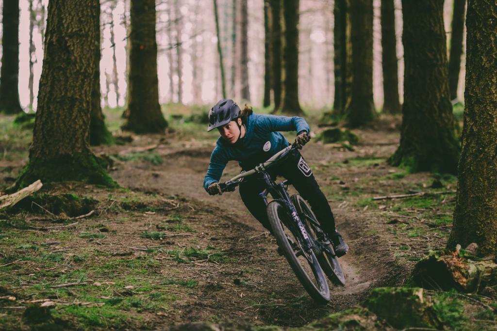 Katy Curd riding singletrack