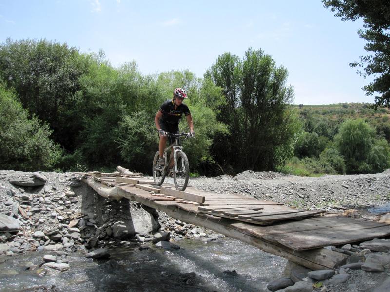 Nics crossing rickety bridge